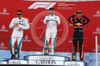 World © Octane Photographic Ltd. Formula 1 – Spanish GP - Sunday Podium. Mercedes AMG Petronas Motorsport AMG F1 W09 EQ Power+ - Lewis Hamilton (1st) Valtteri Bottas (2nd) and Aston Martin Red Bull Racing TAG Heuer RB14 – Max Verstappen (3rd). Circuit de Barcelona-Catalunya, Spain. Sunday 13th May 2018.