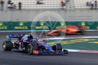 World © Octane Photographic Ltd. Formula 1 – Abu Dhabi GP - Practice 2. Scuderia Toro Rosso STR14 – Pierre Gasly and Scuderia Ferrari SF90 – Charles Leclerc. Yas Marina Circuit, Abu Dhabi, UAE. Friday 29th November 2019.