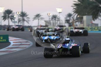 World © Octane Photographic Ltd. Formula 1 – Abu Dhabi GP - Race. Scuderia Toro Rosso STR14 – Pierre Gasly with missing front wing trails the pack up the hill through turn 2. Yas Marina Circuit, Abu Dhabi, UAE. Sunday 1st December 2019.