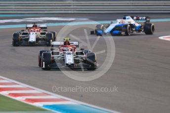 World © Octane Photographic Ltd. Formula 1 – Abu Dhabi GP - Race. Alfa Romeo Racing C38 – Antonio Giovinazzi and Kimi Raikkonen with ROKiT Williams Racing FW 42 – George Russell. Yas Marina Circuit, Abu Dhabi, UAE. Sunday 1st December 2019.
