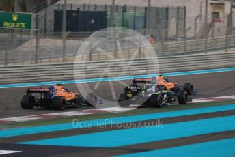 World © Octane Photographic Ltd. Formula 1 – Abu Dhabi GP - Race. McLaren MCL34 – Lando Norris and Carlos Sainz with Renault Sport F1 Team RS19 – Daniel Ricciardo. Yas Marina Circuit, Abu Dhabi, UAE. Sunday 1st December 2019.