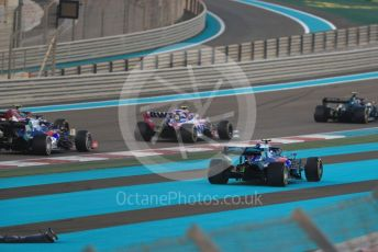 World © Octane Photographic Ltd. Formula 1 – Abu Dhabi GP - Race. Scuderia Toro Rosso STR14 – Pierre Gasly (with missing front wing) runs wide through turn1. Yas Marina Circuit, Abu Dhabi, UAE. Sunday 1st December 2019.