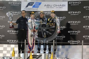 World © Octane Photographic Ltd. FIA Formula 2 (F2) – Abu Dhabi GP - Race 1. DAMS - Sergio Sette Camara, Carlin - Nobuharu Matsushita and Virtuosi Racing - Guanyu Zhou with DAMS team boss - Francois Sicard. Yas Marina Circuit, Abu Dhabi, UAE. Saturday 30th November 2019.