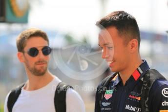 World © Octane Photographic Ltd. Formula 1 – Abu Dhabi GP - Paddock. Aston Martin Red Bull Racing RB15 – Alexander Albon and Haas F1 Team VF19 – Romain Grosjean. Yas Marina Circuit, Abu Dhabi, UAE. Thursday 28th November 2019.