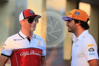 World © Octane Photographic Ltd. Formula 1 – Abu Dhabi GP - Paddock. McLaren MCL34 – Carlos Sainz and Alfa Romeo Racing C38 – Kimi Raikkonen. Yas Marina Circuit, Abu Dhabi, UAE. Thursday 28th November 2019.