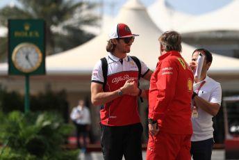 World © Octane Photographic Ltd. Formula 1 – Abu Dhabi GP - Paddock. Alfa Romeo Racing C38 – Antonio Giovinazzi and Gino Rosato – Ferrari Corporate Affairs. Yas Marina Circuit, Abu Dhabi, UAE. Thursday 28th November 2019.
