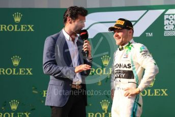 World © Octane Photographic Ltd. Formula 1 – Australian GP Podium. Mercedes AMG Petronas Motorsport AMG F1 W10 EQ Power+ - Valtteri Bottas interviewed by Mark Webber. Melbourne, Australia. Sunday 17th March 2019.