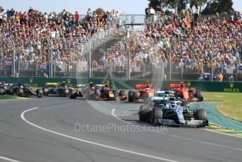 World © Octane Photographic Ltd. Formula 1 – Australian GP Race. Mercedes AMG Petronas Motorsport AMG F1 W10 EQ Power+ - Valtteri Bottas and Lewis Hamilton lead in turn 1 on lap 1. Melbourne, Australia. Sunday 17th March 2019.