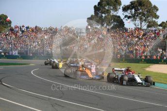 World © Octane Photographic Ltd. Formula 1 – Australian GP Race. Alfa Romeo F1 Team C38 – Kimi Raikkonen and McLaren MCL34 – Lando Norris. Melbourne, Australia. Sunday 17th March 2019.