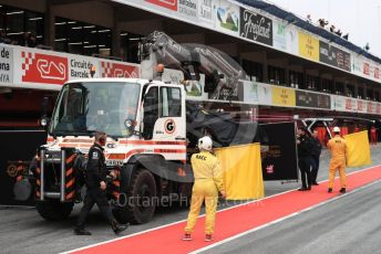 World © Octane Photographic Ltd. Formula 1 – Winter Testing - Test 1 - Day 3. Rich Energy Haas F1 Team VF19 – Romain Grosjean car gets returned to the pit lane. Circuit de Barcelona-Catalunya. Wednesday 20th February 2019.