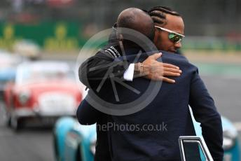 World © Octane Photographic Ltd. Formula 1 – British GP - Drivers Parade. Mercedes AMG Petronas Motorsport AMG F1 W10 EQ Power+ - Lewis Hamilton and Antony Hamilton. Silverstone Circuit, Towcester, Northamptonshire. Sunday 14th July 2019.