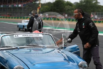 World © Octane Photographic Ltd. Formula 1 – British GP - Drivers Parade. Mercedes AMG Petronas Motorsport AMG F1 W10 EQ Power+ - Lewis Hamilton and Nic Hamilton. Silverstone Circuit, Towcester, Northamptonshire. Sunday 14th July 2019.