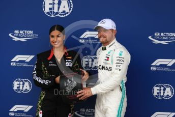 World © Octane Photographic Ltd. Formula 1 – British GP - Qualifying. Mercedes AMG Petronas Motorsport AMG F1 W10 EQ Power+ - Valtteri Bottas receives the Pirelli Pole Position Award from the Pirelli Representative, pop star Mabel McVey. Silverstone Circuit, Towcester, Northamptonshire. Saturday 13th July 2019.