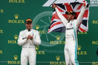 World © Octane Photographic Ltd. Formula 1 – British GP - Race - Podium. Mercedes AMG Petronas Motorsport AMG F1 W10 EQ Power+ - Lewis Hamilton and Valtteri Bottas. Silverstone Circuit, Towcester, Northamptonshire. Sunday 14th July 2019.