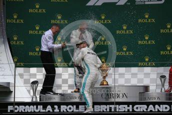 World © Octane Photographic Ltd. Formula 1 – British GP - Race - Podium. Mercedes AMG Petronas Motorsport AMG F1 W10 EQ Power+ - Lewis Hamilton and Valtteri Bottas. Silverstone Circuit, Towcester, Northamptonshire. Sunday 14th July 2019.