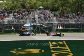 World © Octane Photographic Ltd. Formula 1 – Canadian GP. Practice 2. Alfa Romeo Racing C38 – Kimi Raikkonen and Mercedes AMG Petronas Motorsport AMG F1 W10 EQ Power+ - Valtteri Bottas. Circuit de Gilles Villeneuve, Montreal, Canada. Friday 7th June 2019.