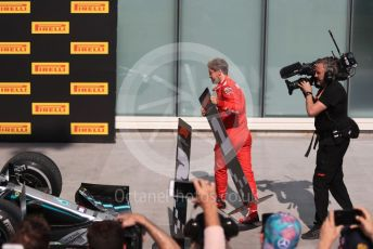 World © Octane Photographic Ltd. Formula 1 – Canadian GP. Parc Ferme. Scuderia Ferrari SF90 – Sebastian Vettel switches the first and second position boards. Circuit de Gilles Villeneuve, Montreal, Canada. Sunday 9th June 2019.