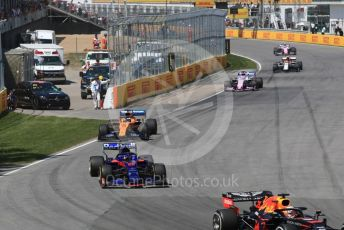 World © Octane Photographic Ltd. Formula 1 – Canadian GP. Race. Scuderia Toro Rosso STR14 – Daniil Kvyat and McLaren MCL34 – Carlos Sainz. Circuit de Gilles Villeneuve, Montreal, Canada. Sunday 9th June 2019.