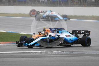 World © Octane Photographic Ltd. Formula 1 – German GP - Race. ROKiT Williams Racing FW 42 – George Russell and Robert Kubica sandwiching McLaren MCL34 – Lando Norris . Hockenheimring, Hockenheim, Germany. Sunday 28th July 2019.
