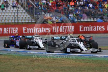 World © Octane Photographic Ltd. Formula 1 – German GP - Race. Mercedes AMG Petronas Motorsport AMG F1 W10 EQ Power+ - Valtteri Bottas and Lewis Hamilton with Scuderia Toro Rosso STR14 – Alexander Albon. Hockenheimring, Hockenheim, Germany. Sunday 28th July 2019.