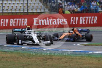World © Octane Photographic Ltd. Formula 1 – German GP - Race. Mercedes AMG Petronas Motorsport AMG F1 W10 EQ Power+ - Valtteri Bottas and McLaren MCL34 – Carlos Sainz. Hockenheimring, Hockenheim, Germany. Sunday 28th July 2019.