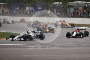 World © Octane Photographic Ltd. Formula 1 – German GP - Race. Mercedes AMG Petronas Motorsport AMG F1 W10 EQ Power+ Valtteri Bottas ahead of Alfa Romeo Racing C38 – Kimi Raikkonen and the rest of the pack. Hockenheimring, Hockenheim, Germany. Sunday 28th July 2019.