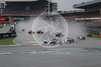 World © Octane Photographic Ltd. Formula 1 – German GP - Race. Mercedes AMG Petronas Motorsport AMG F1 W10 EQ Power+ - Lewis Hamilton and Valtteri Bottas lead the pack. Hockenheimring, Hockenheim, Germany. Sunday 28th July 2019.
