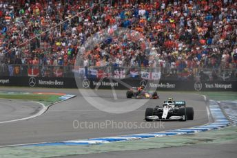 World © Octane Photographic Ltd. Formula 1 – German GP - Race. Mercedes AMG Petronas Motorsport AMG F1 W10 EQ Power+ - Valtteri Bottas and Aston Martin Red Bull Racing RB15 – Max Verstappen. Hockenheimring, Hockenheim, Germany. Sunday 28th July 2019.