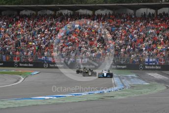 World © Octane Photographic Ltd. Formula 1 – German GP - Race. Rich Energy Haas F1 Team VF19 – Romain Grosjean and ROKiT Williams Racing FW 42 – George Russell with Renault Sport F1 Team RS19 – Daniel Ricciardo. Hockenheimring, Hockenheim, Germany. Sunday 28th July 2019.