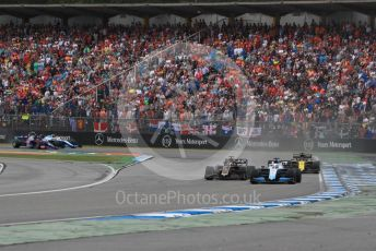 World © Octane Photographic Ltd. Formula 1 – German GP - Race. Rich Energy Haas F1 Team VF19 – Romain Grosjean and ROKiT Williams Racing FW 42 – George Russell with Renault Sport F1 Team RS19 – Daniel Ricciardo. Hockenheimring, Hockenheim, Germany. Sunday 28th July 2019.