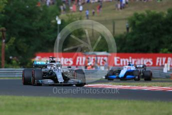 World © Octane Photographic Ltd. Formula 1 – Hungarian GP - Practice 1. Mercedes AMG Petronas Motorsport AMG F1 W10 EQ Power+ - Lewis Hamilton and ROKiT Williams Racing FW 42 – George Russell. Hungaroring, Budapest, Hungary. Friday 2nd August 2019.