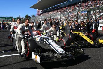 World © Octane Photographic Ltd. Formula 1 – Japanese GP - Grid. Alfa Romeo Racing C38 – Kimi Raikkonen and Renault Sport F1 Team RS19 – Nico Hulkenberg. Suzuka Circuit, Suzuka, Japan. Sunday 13th October 2019.