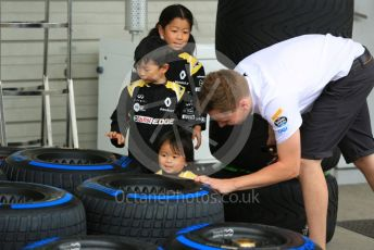 World © Octane Photographic Ltd. Formula 1 – Japanese GP - Paddock. Young Renault fans helps a McLaren tyre technicianPirelli full wet tyre. Suzuka Circuit, Suzuka, Japan. Thursday 10th October 2019.