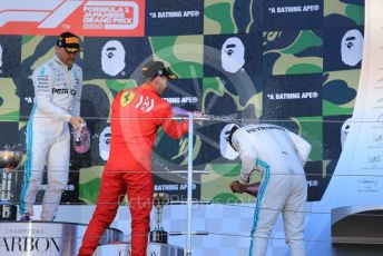 World © Octane Photographic Ltd. Formula 1 – Japanese GP - Podium. Mercedes AMG Petronas Motorsport AMG F1 W10 EQ Power+ - Valtteri Bottas and Lewis Hamilton, Scuderia Ferrari SF90 – Sebastian Vettel. Suzuka Circuit, Suzuka, Japan. Sunday 13th October 2019.