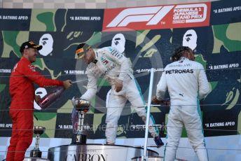 World © Octane Photographic Ltd. Formula 1 – Japanese GP - Podium. Mercedes AMG Petronas Motorsport AMG F1 W10 EQ Power+ - Valtteri Bottas and Lewis Hamilton, Scuderia Ferrari SF90 – Sebastian Vettel. Suzuka Circuit, Suzuka, Japan. Sunday 13th October 2019.