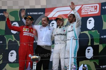 World © Octane Photographic Ltd. Formula 1 – Japanese GP - Podium. Mercedes AMG Petronas Motorsport AMG F1 W10 EQ Power+ - Valtteri Bottas and Lewis Hamilton with Chief Aerodynamicist, Scuderia Ferrari SF90 – Sebastian Vettel. Suzuka Circuit, Suzuka, Japan. Sunday 13th October 2019.
