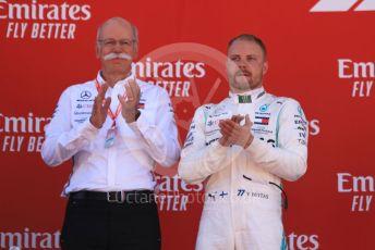 World © Octane Photographic Ltd. Formula 1 – Spanish GP. Podium. Mercedes AMG Petronas Motorsport AMG F1 W10 EQ Power+ - Valtteri Bottas and Dieter Zetsche – Chairman of the management board of Mercedes. Circuit de Barcelona Catalunya, Spain. Sunday 12th May 2019.