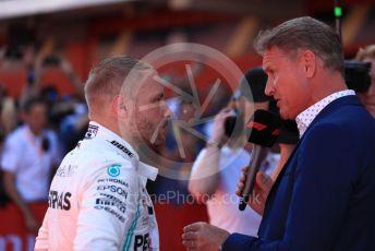 World © Octane Photographic Ltd. Formula 1 – Spanish GP. Parc Ferme. Mercedes AMG Petronas Motorsport AMG F1 W10 EQ Power+ - Valtteri Bottas with David Coulthard. Circuit de Barcelona Catalunya, Spain. Sunday 12th May 2019.