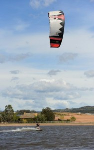 A kiteboarder on the North Weston Pond, which was troubled by asbestos land contamination. Photo: Graham Tidy