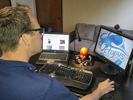 chris at his desk