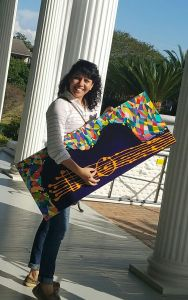 Artist Ines Alvarides with guitar painting