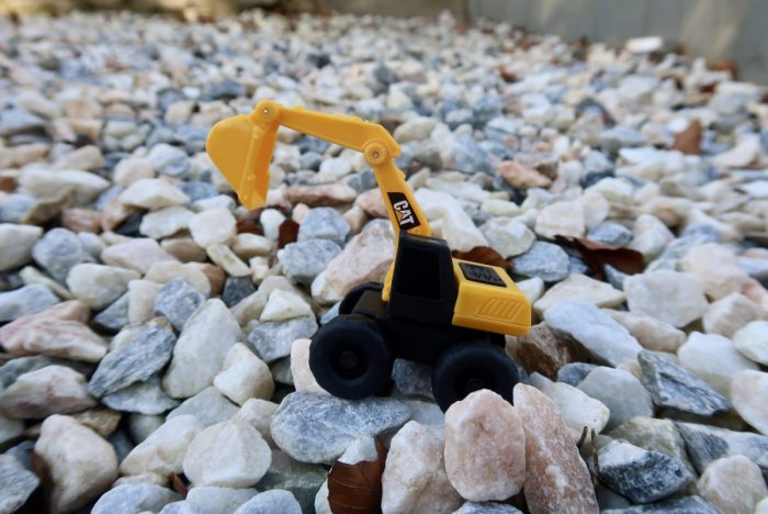 A small Cat toy digger on stones