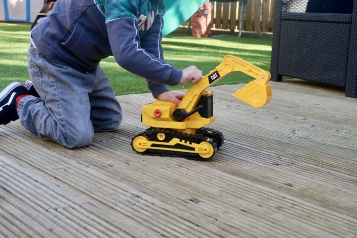 A child playing with a Cat toy digger