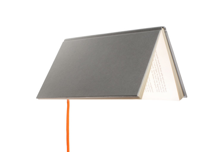 The Bookshade Is A Lamp That Uses A Book As The Lamp Shade