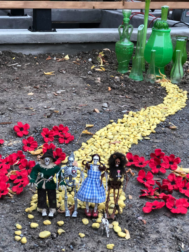 Tiny and creepy yellow brick road on neighbor's front lawn