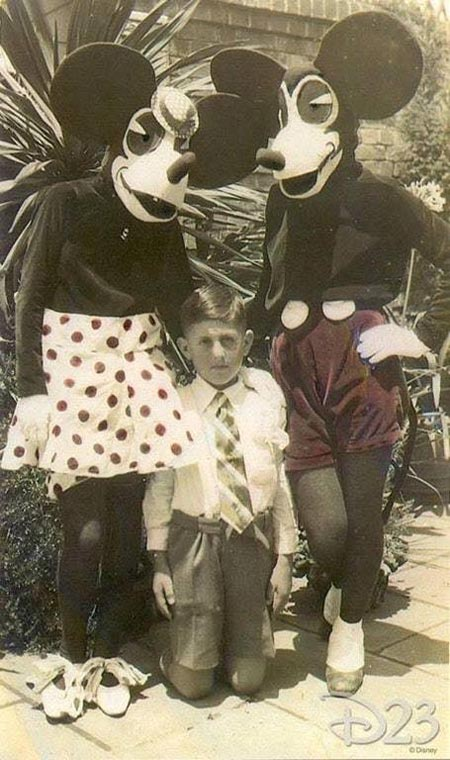 A child poses with the first Mickey and Minnie Mouse costumes in 1939. Walt Disney was very unhappy with the original costumes, and said it looked like some kind of ransom demand