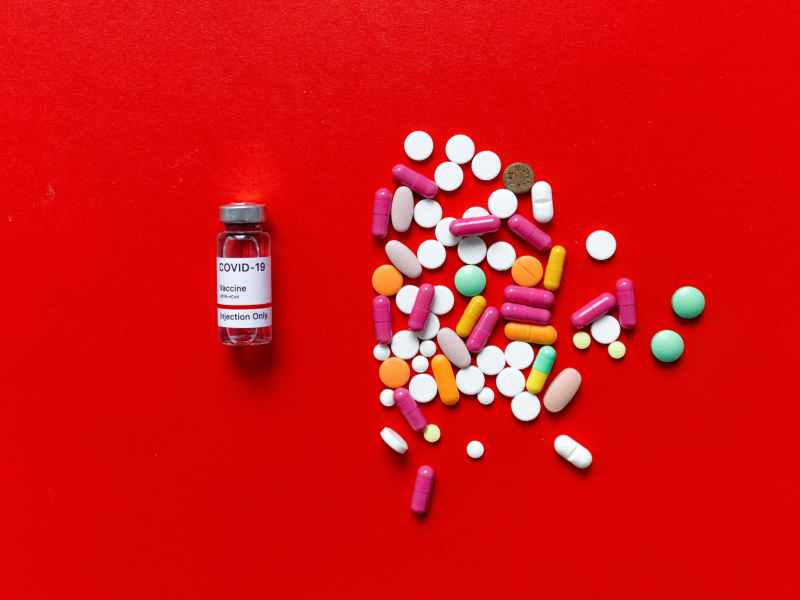 white and red labeled medication pill bottle
