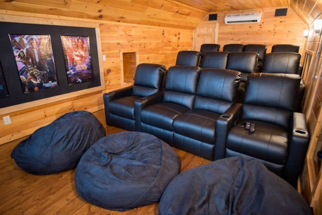 It's Movie Night! - Located above the garage and the 2nd game room, the spacious home theater has 12 leather reclining seats and several bean bags from which you can watch a movie on the 10-foot screen with surround sound.