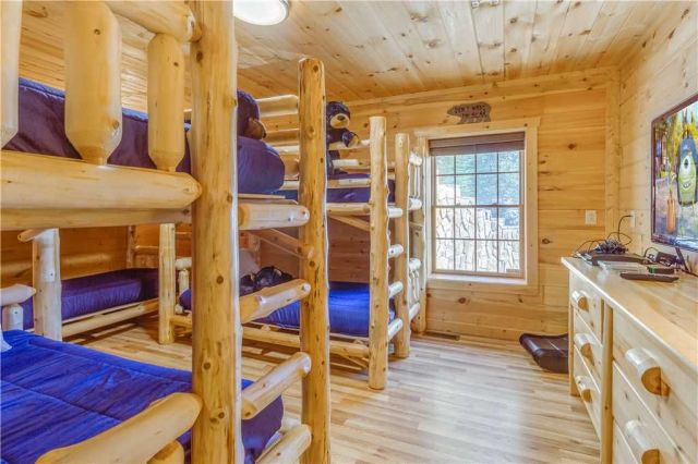 Log Bunk Beds - All three bunk beds have memory foam mattresses. Great for a kids slumber party since it offers a Large Flat Screen TV with a Playstation 3 and gaming chairs.