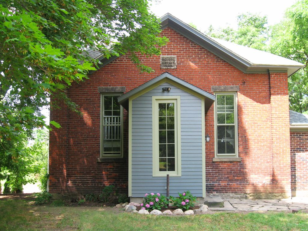Charmingly Restored Converted One Room Brick Schoolhouse